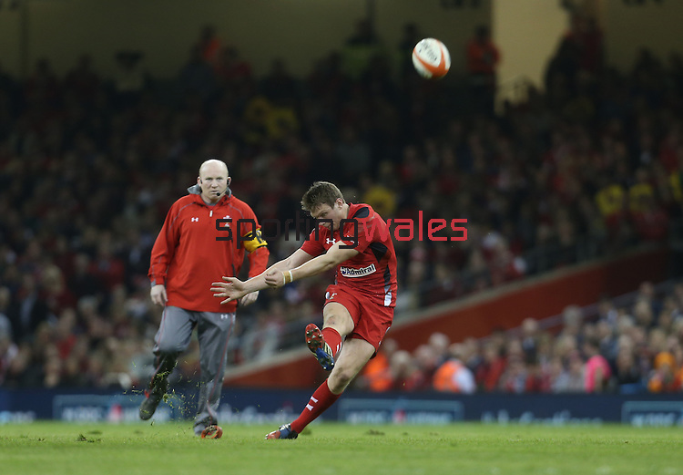 Outside half Dan Biggar kicks a penalty for Wales watched by kicking coach Neil Jenkins.<br /> RBS 6 Nations 2014<br /> Wales v Scotland<br /> Millennium Stadium<br /> <br /> 15.03.14<br /> <br /> ©Steve Pope-SPORTINGWALES
