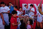 Children touch a model bull used to train bullfighters after the bull run of the San Sebastian de los Reyes Festival near Madrid, on August 26, 2014. © Pedro ARMESTRE