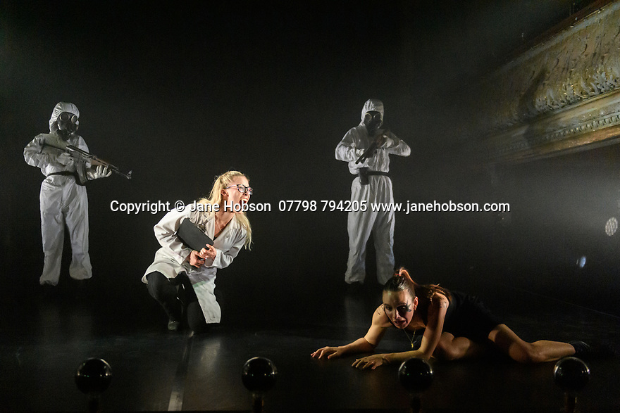 """London, UK. 27.02.20. Mark Bruce Company presents """"Return to Heaven"""", at Wilton's Music Hall. Written and choreographed by Mark Bruce, with costume design by Dorothee Brodruck, lighting design by Guy Hoare, and set design by Phil Eddolls. The dancers are: Jordi Calpe-Serrats, Eleanor Duval, Carina Howard, Dane Hurst, Sharol Mackenzie, Christopher Thomas. Picture shows: Carina Howard, Eleanor Duval. Photograph © Jane Hobson."""