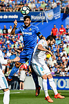 Jorge Molina Vidal of Getafe CF (top) fights for the ball with Jose Ignacio Fernandez Iglesias, Nacho, of Real Madrid (R) during the La Liga 2017-18 match between Getafe CF and Real Madrid at Coliseum Alfonso Perez on 14 October 2017 in Getafe, Spain. Photo by Diego Gonzalez / Power Sport Images