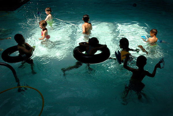 A skylight lights up the indoor pool as special education students swim in the Mary Lou Clack therapy pool in Vista.