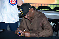 Baseball Hall of Famer Andre Dawson signs autographs prior to the International League game between the Toledo Mud Hens and the Charlotte Knights at BB&T BallPark on April 24, 2019 in Charlotte, North Carolina. The Knights defeated the Mud Hens 9-6. (Brian Westerholt/Four Seam Images)