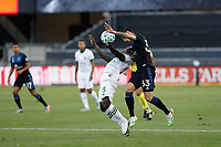 SAN JOSE, CA - SEPTEMBER 16: Paul Marie #33 of the San Jose Earthquakes goes up for a header with Yimmi Chara #23 of the Portland Timbers during a game between Portland Timbers and San Jose Earthquakes at Earthquakes Stadium on September 16, 2020 in San Jose, California.