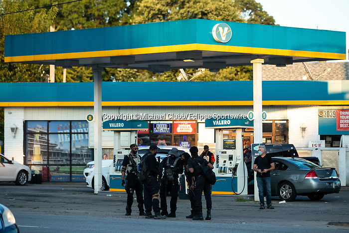 "September 5, 2020:  Members of the NFAC stand in the parking lot of a gas station outside of Churchill Downs after the 146th Kentucky Derby. With the Kentucky Derby being the biggest sports event for the State of Kentucky, protestors have chosen the  event as a focal point for their calls for justice in the death of Breonna Taylor. Multiple groups from around the country have converged on Louisville to protest during the ""Run for the Roses"" at Churchill Downs in Louisville. Michael Clubb/Eclipse Sportswire/CSM"