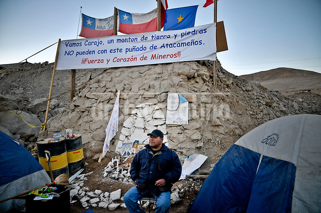 Relatives and friends wait outside the mine where 33 miners are trapped in a collapsed tunnel in North Chile since August 5th.