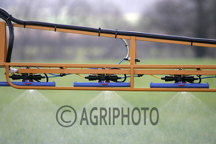 Crop Sprayer Spraying Chemicals On To Wheat Plants