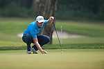 Lucas Bjerregaard of Denmark places his ball during Hong Kong Open golf tournament at the Fanling golf course on 24 October 2015 in Hong Kong, China. Photo by Xaume Olleros / Power Sport Images