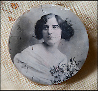 BNPS.co.uk (01202 558833)<br /> Pic: PhilYeomans/BNPS<br /> <br /> Locket picture of Pte Ambrose's sweetheart Gladys.<br /> <br /> Discovered in a loft - Poingnant reminder of families tragic loss during the Great War.<br /> <br /> A moving time capsule containing the last belongings of a dead soldier his family couldn't bring themselves to look at has been found in an attic after 98 years.<br /> <br /> The possessions of Private Edward Ambrose were sent home from the Western Front to his devastated parents after he was killed at the Somme.<br /> <br /> Too painful to look at, the poignant items were shut into a leather case and put into storage where they remained for almost a century.<br /> <br /> The case has now been opened by Pvt Ambrose's 82-year-old nephew who recovered it after reading about an appeal for untold stories for a local First World War exhibition.<br /> <br /> The effects include black and white photos of his loved ones, letters from his parents, his half-smoked pipe and a cigarette case with 10 roll-ups.