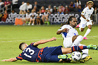KANSAS CITY, KS - JULY 15: Matthew Hoppe #13 of the United States ,Dondon Gerald #4 of Martinique during a game between Martinique and USMNT at Children's Mercy Park on July 15, 2021 in Kansas City, Kansas.
