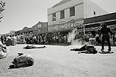 Tombstone, Arizona.USA.October 21, 2006..In this small historical town, where the shoot out at the OK Coral took place, residence dress up in old period costumes at least once a month and stroll the streets and bars as in the old days. Theatrical shoot-outs take place on the main street all day long. ..It is the town where the Minutemen, who unofficially patrol the border, originates from. The civilian patrols stay along the border and encourage illegal immigrants to sit until the official border patrol arrives to return them to Mexico. Most of Minutemen carry guns for their own protection. ..