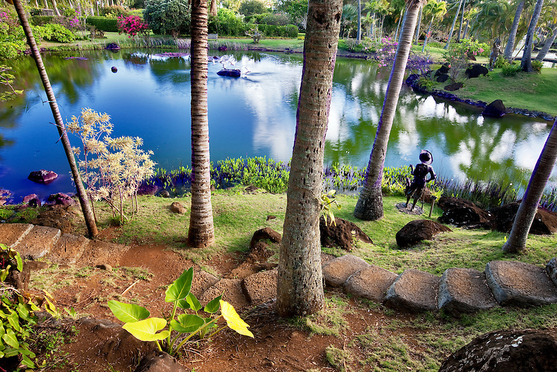 Pond and garden sculpture at Na Aina Kai Botanical Gardens. Kauai, Hawaii