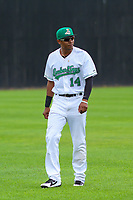 Clinton LumberKings outfielder Dimas Ojeda (14) warms up in the outfield prior to a Midwest League game against the Lansing Lugnuts on July 15, 2018 at Ashford University Field in Clinton, Iowa. Clinton defeated Lansing 6-2. (Brad Krause/Four Seam Images)