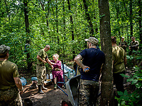 Natalia Voronkova, a volunteer who offers support and basic first aid training for Ukrainian government forces fighting Russian-backed separatists in the east of the country, gathers a group of soldiers for a role-play of real life medical situations that may be encountered by soldiers fighting on the frontlines.