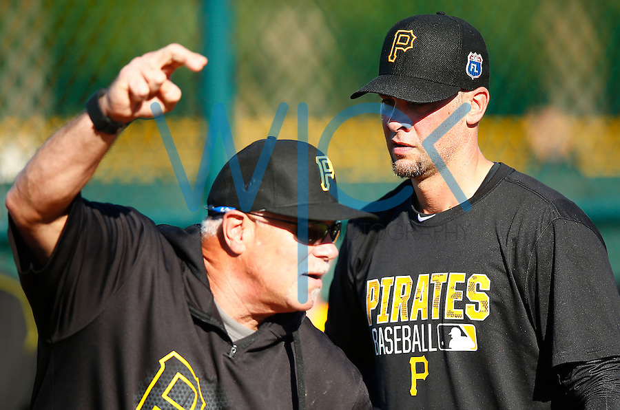 Pitching coach Ray Searage gives instruction in the bullpen to Ryan Vogelsong #14 of the Pittsburgh Pirates during spring training at Pirate City in Bradenton, Florida on February 17, 2016. (Photo by Jared Wickerham / DKPS)