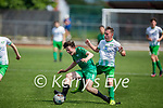 Kerry's Oisin Breen feels the pressure from  Cabinteely's Tadgh Kane and Sean Dowling  in the U17 League of Ireland
