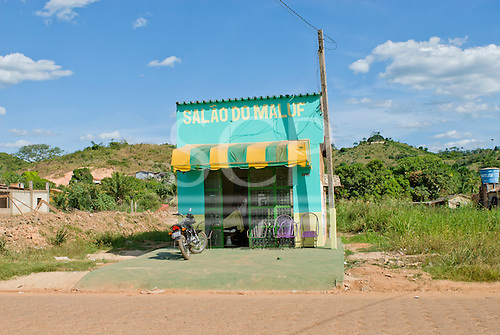 Pará State, Brazil. São Félix do Xingu. Salão do Maluf barber's shop in isolated building, surrounded by derelict land.