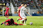 Musa Altmari of Jordan (R) fights for the ball with Paul Olivier Ngue of Hong Kong (L) during the International Friendly match between Hong Kong and Jordan at Mongkok Stadium on June 7, 2017 in Hong Kong, China. Photo by Cris Wong / Power Sport Images
