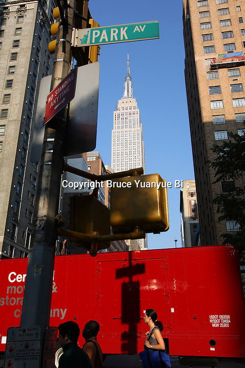 Empire State Building seen between city high-rise buildings on Park Avenue. New York City. USA