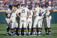 Michigan Wolverines huddle before Game 1 of the NCAA College World Series Finals on June 24, 2019 at TD Ameritrade Park in Omaha, Nebraska. Michigan defeated Vanderbilt 7-4. (Andrew Woolley/Four Seam Images)