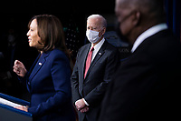 US President Joe Biden (C) listens to US Vice President Kamala Harris (L) deliver remarks to Department of Defense personnel as US Secretary of Defense Lloyd Austin (R) looks on, at the Pentagon in Arlington, Virginia, USA, 10 February 2021.<br /> CAP/MPI/RS<br /> ©RS/MPI/Capital Pictures