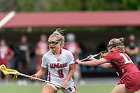 NEWTON, MA - MAY 14: Kylee Bowen #9 of University of Massachusetts looks to pass as Katie Shallow #13 of Temple University defends during NCAA Division I Women's Lacrosse Tournament first round game between University of Massachusetts and Temple University at Newton Campus Lacrosse Field on May 14, 2021 in Newton, Massachusetts.