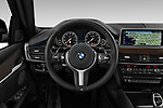 Car pictures of steering wheel view of a 2019 BMW X6 35i 5 Door SUV