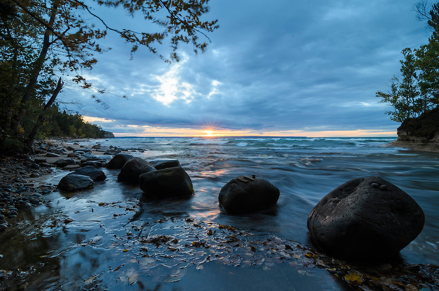 A beautiful sunset along the Pictured Rocks shoreline at the mouth of the Mosquito River. Munising, MI
