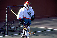 Native American Indian Goalie defending Net in a Game of Lacrosse