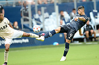 KANSAS CITY, KS - JUNE 26: Alan Pulido #9 Sporting KC injures his ankle with this shot on the LA goal during a game between Los Angeles FC and Sporting Kansas City at Children's Mercy Park on June 26, 2021 in Kansas City, Kansas.