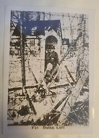 BNPS.co.uk (01202 558833)<br /> Pic: TheCotswoldAuctionCompany/BNPS<br /> <br /> Pictured: Dulag Luft.<br /> <br /> A remarkable cache of rarely seen photos capturing life inside the Great Escape PoW camp has been discovered in a barn.<br /> <br /> The images, taken at Stalag Luft III in 1942 and 1943, show Allied prisoners dressed as women doing amateur-dramatics and an action-packed sports day.<br /> <br /> They donned bikinis and other extravagant outfits as they entertained their camp mates with performances of 'Aladdin' and 'Girls, Girls, Girls'.<br /> <br /> Hundreds of PoWs perched on roofs to watch the sports day which featured sprint races, the long jump, the high jump and a discus competition.