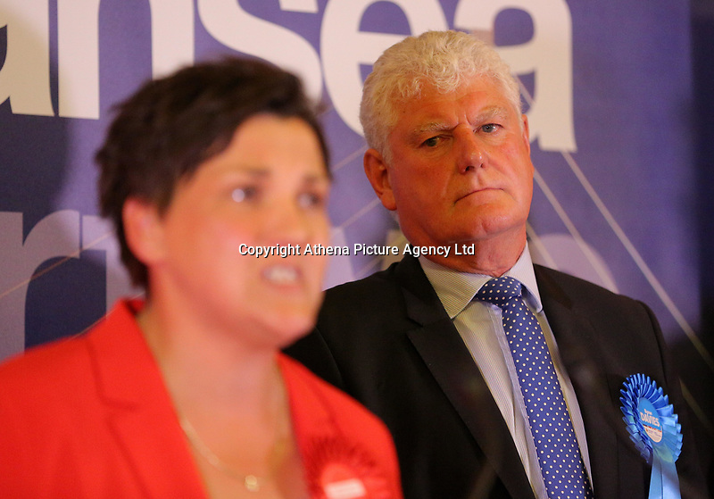 Pictured: Conservative candidate Byron Davies (R) looks on as Labour candidate for Gower constituency Tonia Antoniazzi gives a speech after her win was announced.  Friday 09 June 2017<br />Re: Counting of ballots at Brangwyn Hall for the general election in Swansea, Wales, UK