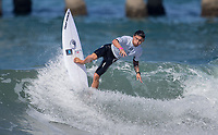 Huntington Beach, CA - Tuesday July 31, 2018: Flavio Nakagima in action during a World Surf League (WSL) Qualifying Series (QS) Men's round of 96 heat at the 2018 Vans U.S. Open of Surfing on South side of the Huntington Beach pier.