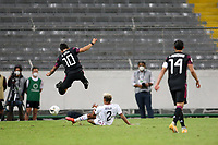 GUADALAJARA, MEXICO - MARCH 24: Alexis Vega #10 of Mexico flies over the tackle of Julian Araujo #2 of the United States during a game between Mexico and USMNT U-23 at Estadio Jalisco on March 24, 2021 in Guadalajara, Mexico.