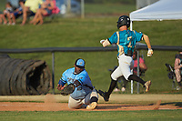 Dry Pond Blue Sox first baseman Derek Farley (40) (SouthLake Christian HS) stretches for a low throw as Justin Fox (2) (Erskine College) of the Mooresville Spinners lunges for the base at Moor Park on July 2, 2020 in Mooresville, NC.  The Spinners defeated the Blue Sox 9-4. (Brian Westerholt/Four Seam Images)