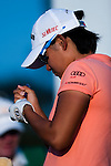 TAOYUAN, TAIWAN - OCTOBER 22: Yani Tseng of Taiwan marks her golf ball on the 17th tee during day three of the LPGA Imperial Springs Taiwan Championship at Sunrise Golf Course on October 22, 2011 in Taoyuan, Taiwan. Photo by Victor Fraile / The Power of Sport Images