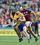 Tony Kelly of Clare in action against Adrian Tuohey and Johnny Coen of Galway during their All-Ireland semi-final at Croke Park. Photograph by John Kelly.