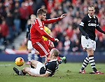 David Goodwillie blocked by the challenge from Sean Dillon