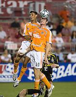Houston Dynamo forwards Chris Wondolowski (7) and Nate Jaqua (21) go for the header. The Houston Dynamo tied the Columbus Crew 1-1 in a regular season MLS match at Robertson Stadium in Houston, TX on August 25, 2007.