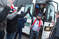 American Outlaws cheer fans arriving at the stadium in a bus before the USA Men's National Team's World Cup Qualifier against Costa Rica at Dick's Sporting Good Park in Commerce City, CO on March 22, 2013.