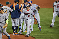 Minnesota Twins Brian Dozier high fives Oakland Athletics Sonny Gray after closing out the MLB All-Star Game on July 14, 2015 at Great American Ball Park in Cincinnati, Ohio.  (Mike Janes/Four Seam Images)