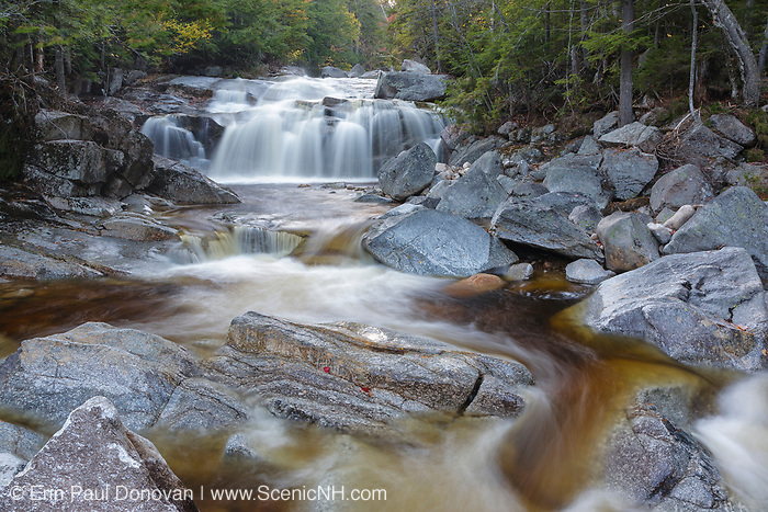 A scenic cascade along the Swift River in the White Mountains town of Livermore, New Hampshire during the autumn months. This area is near the Sawyer River Trail and is within the White Mountain National Forest.