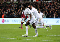 Pictured: Bafetimbi Gomis of Swansea celebrating his equaliser Saturday 10 January 2015<br /> Re: Barclays Premier League, Swansea City FC v West Ham United at the Liberty Stadium, south Wales, UK