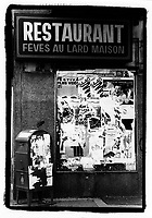 1987 File Photo - Montreal (Qc) Canada - Restaurant Feve au Lard Maison atop a torn poster and a mailbox