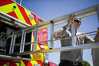Firefighter Hayden Johnson inspects a ladder, Friday, April 30, 2021 at the Lowell Fire Department in Lowell. Lowell will hold a special election May 10 for voters to extend a current 1 cent sales tax which funds about 70 percent of the city's operating budget. A bulk of the money goes to the fire department, police department and roads. Check out nwaonline.com/210501Daily/ for today's photo gallery. <br /> (NWA Democrat-Gazette/Charlie Kaijo)