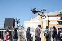 SXSW attendees take in live aerial action as professional BMX riders perform high air tricks and exciting demos during the annual SXSW Music Festival.