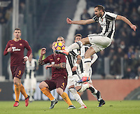 Calcio, Serie A: Juventus vs Roma. Torino, Juventus Stadium,17 dicembre 2016. <br /> Juventus' Giorgio Chiellini, right, controls the ball past Roma's Radja Nainggolan, center, during the Italian Serie A football match between Juventus and Roma at Turin's Juventus Stadium, 17 December 2016.<br /> UPDATE IMAGES PRESS/Isabella Bonotto