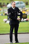 © Joel Goodman - 07973 332324 . 17/03/2012 . Staffordshire , UK . A police officer in dress uniform stands alone outside the crematorium and listens to the service as it is relayed on loudspeaker . The funeral of former police officer David Rathband , at Stafford Crematorium . Rathband was found dead at his home in Blyth on 29th February 2012 . He was shot and blinded by killer Raoul Moat whilst he was on duty in the early hours of 4th July 2010 and went on to campaign for the Blue Lamp Foundation , which supports emergency staff injured in the line of duty , but he was reported to have never overcome the psychological impact of his injuries . Photo credit : Joel Goodman