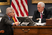 Vice President Mike Pence meets with Dr. Anthony S. Fauci, Director of the National Institute of Allergy and Infectious Diseases Wednesday, March 11, 2020, in his West Wing Office of the White House. <br /> <br /> <br /> People:  Vice President Mike Pence, Dr. Anthony S. Fauci