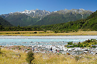 Whataroa River in Whataroa Gorge and a group of hikers - South Westland, West Coast, New Zealand
