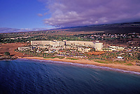 Aerial view of Maui's Grand Wailea hotel, the sky and clouds in the distance, and the beachfront.